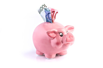 pink piggy bank with euro money