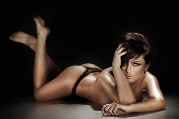 Sexy brunette woman lying and posing