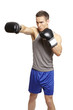 Muscular young man boxing in sports outfit
