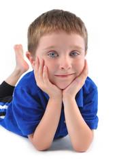Happy Boy Sitting on White Background