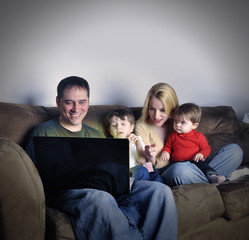 Technology Family at Home on Laptop