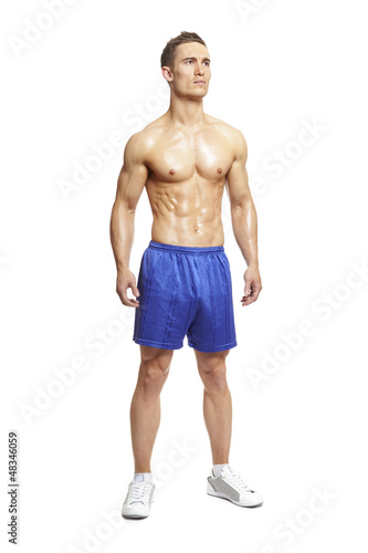 Muscular young man in sports outfit