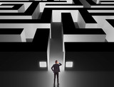 Businessman in front of a huge maze