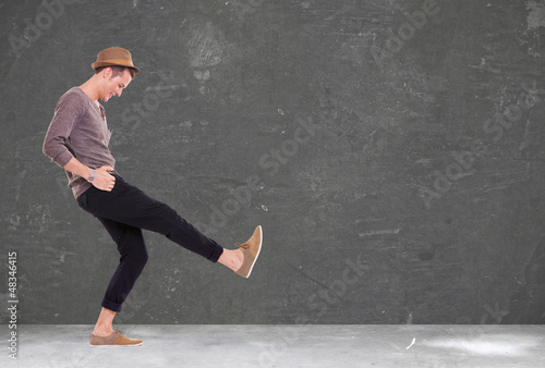 young man kicking and smiling