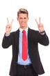 business man showing two fingers or victory gesture