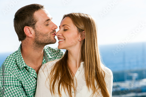 Boyfriend kissing girl on nose.