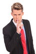 business man showing silence gesture