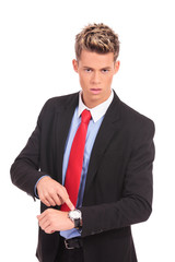 Businessman impatiently pointing to his watc