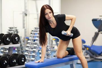 Beautiful slim woman in a gym