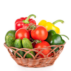 vegetables in basket isolated on a white background