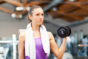 Woman working out in a fitness club