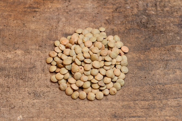 Lentils on wood background
