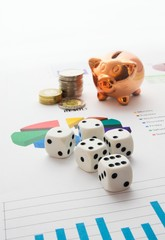 Saving money. Gambling concept.Pig, coins and dices composition