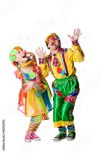 Two cheerful clowns  in the soap bubbles