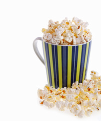 Popcorn in a striped mug