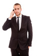 Young businessman using cell phone on white background