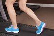 woman legs side treadmill