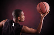 Male basketball player against black background