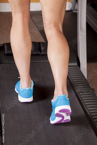 woman legs treadmill back