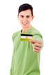 Happy casual man with credit card, isolated on white