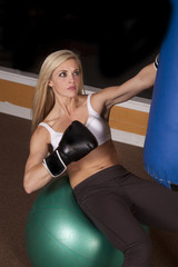 woman sit boxing bag