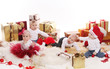 Babies with gifts celebrate Christmas
