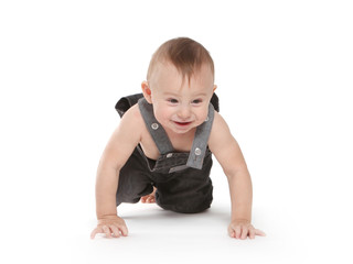 Beautiful toddler in worker coveralls