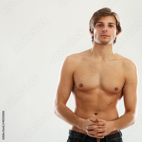 Young beautiful man with naked torso