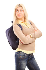 Female student with backpack looking bored