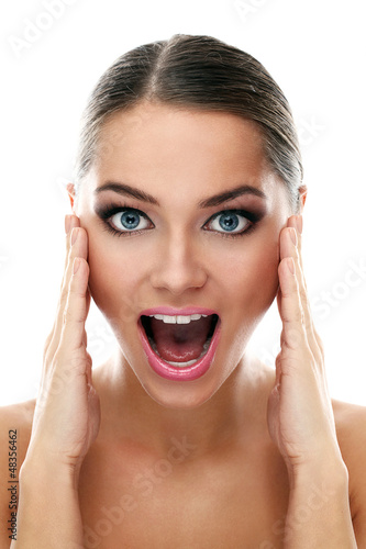 Young beautiful latino woman surprised