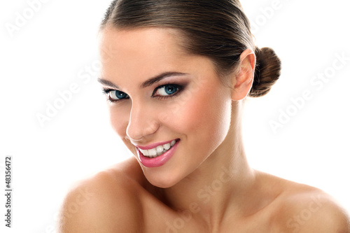 Young latino woman smiling isolated