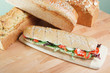 Chicken Salad Sandwich on wooden cutting board