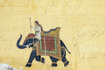 colorful indian mural in the fort at Jodhpur showing a royal pro