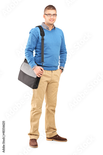 Full length portrait of a young man with a shoulder bag