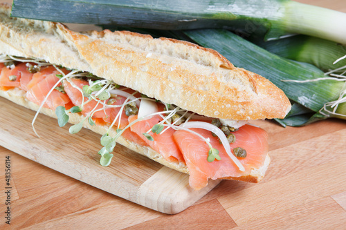 Smoked salmon sandwich with capers on baguette