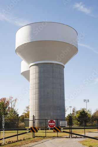 Water Towers Behind Fence