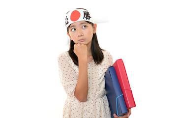 不安げな表情の受験生の女の子