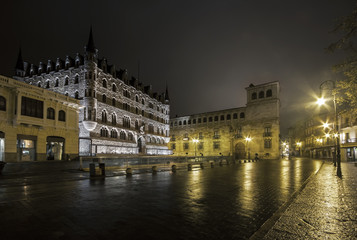Night shot of the Botines and Guzmanes Palaces of Leon in a fogg
