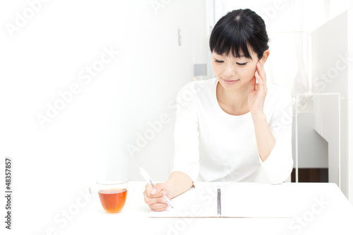 a young asian woman studying