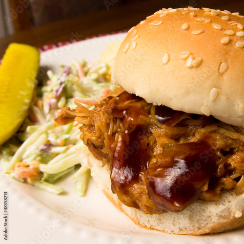 Pulled pork sandwich, coleslaw and pickle