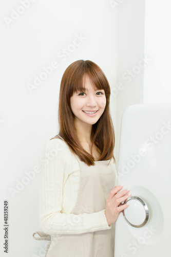 Beautiful asian woman in the kitchen