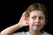 Boy listening with  hand on an ear