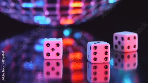 dices and a disco mirror ball on the background