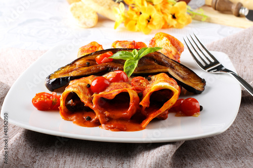 Cannelloni pasta with eggplant and tomato