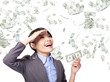 business woman happy with money rain