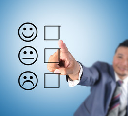 Business man touching emoticon