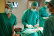 Team of surgeons working on the stomach of a patient