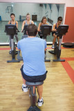 Four women take spinning class
