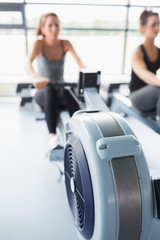 Rowing machine being used in gym