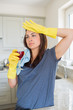 Woman drinking glass of wine after housework